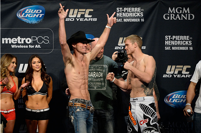 LAS VEGAS, NEVADA - NOVEMBER 15:  (L-R) Donald Cerrone interacts with the crowd as he faces off against Evan Dunham during the UFC 167 weigh-in event at the MGM Grand Garden Arena on November 15, 2013 in Las Vegas, Nevada. (Photo by Jeff Bottari/Zuffa LLC/Zuffa LLC via Getty Images)
