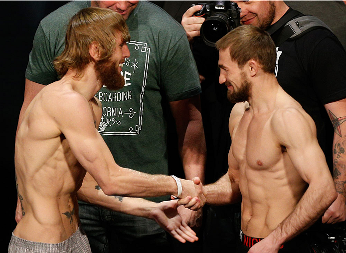 LAS VEGAS, NV - NOVEMBER 15:  (L-R) Opponents Tim Elliott and Ali Bagautinov shake hands during the UFC 167 weigh-in inside the MGM Grand Garden Arena on November 15, 2013 in Las Vegas, Nevada. (Photo by Josh Hedges/Zuffa LLC/Zuffa LLC via Getty Images)