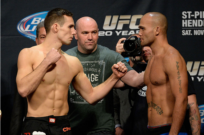 LAS VEGAS, NEVADA - NOVEMBER 15:  (L-R) Rory MacDonald and Robbie Lawler face off during the UFC 167 weigh-in event at the MGM Grand Garden Arena on November 15, 2013 in Las Vegas, Nevada. (Photo by Jeff Bottari/Zuffa LLC/Zuffa LLC via Getty Images)