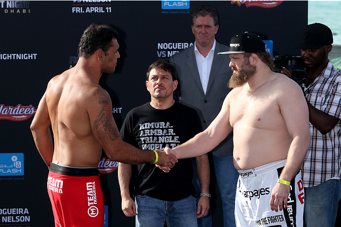 "ABU DHABI, UNITED ARAB EMIRATES - APRIL 10:  Antonio Rodrigo Nogueira and Roy Nelson shake hands after they weigh-in for UFC Fight Night 39 on April 10, 2014 in Abu Dhabi, United Arab Emirates. UFC Fight Night 39 will take place on April 11 at du Arena featuring  Minotauro Nogueira and Roy ""Big Country' Nelson.  (Photo by Warren Little/Zuffa LLC/Zuffa LLC via Getty Images)"