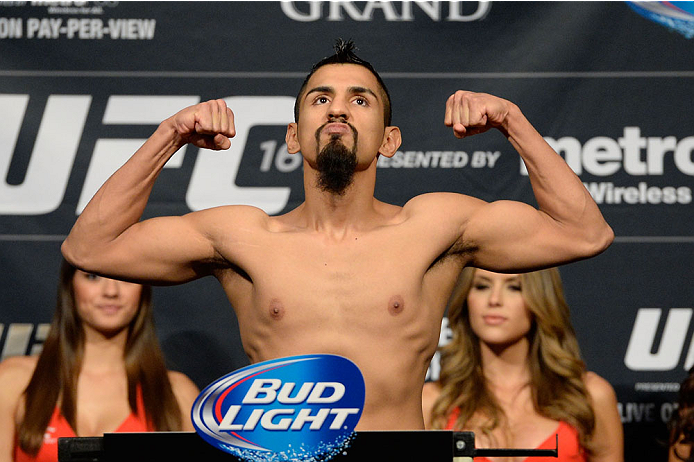 LAS VEGAS, NEVADA - NOVEMBER 15:  Edwin Figueroa weighs in during the UFC 167 weigh-in event at the MGM Grand Garden Arena on November 15, 2013 in Las Vegas, Nevada. (Photo by Jeff Bottari/Zuffa LLC/Zuffa LLC via Getty Images) *** Local Caption *** Edwin Figueroa