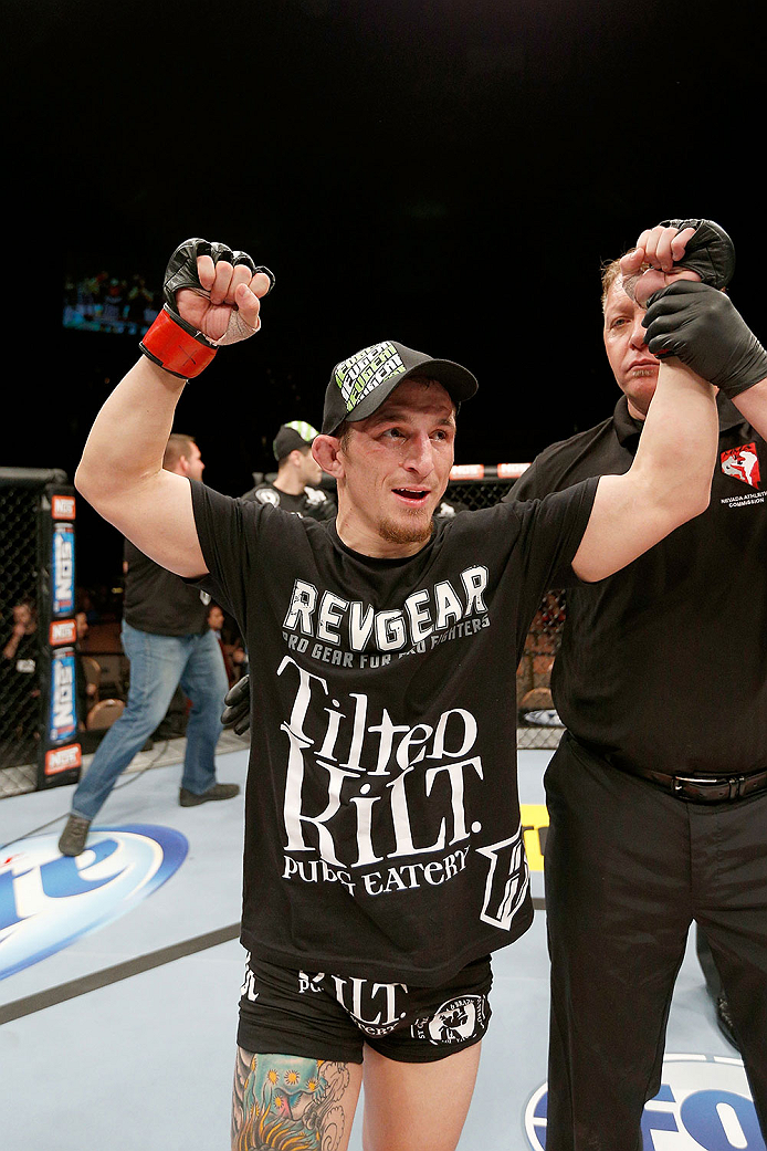 LAS VEGAS, NV - NOVEMBER 30:  Josh Sampo celebrates after submitting Ryan Benoit by rear naked choke in their flyweight fight during The Ultimate Fighter season 18 live finale inside the Mandalay Bay Events Center on November 30, 2013 in Las Vegas, Nevada. (Photo by Josh Hedges/Zuffa LLC/Zuffa LLC via Getty Images) *** Local Caption *** Josh Sampo
