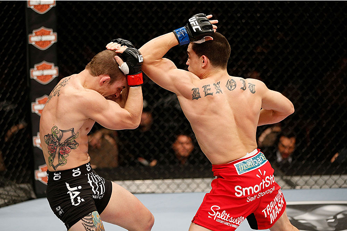LAS VEGAS, NV - NOVEMBER 30:  (R-L) Ryan Benoit throws an elbow at Josh Sampo in their flyweight fight during The Ultimate Fighter season 18 live finale inside the Mandalay Bay Events Center on November 30, 2013 in Las Vegas, Nevada. (Photo by Josh Hedges/Zuffa LLC/Zuffa LLC via Getty Images) *** Local Caption *** Josh Sampo; Ryan Benoit