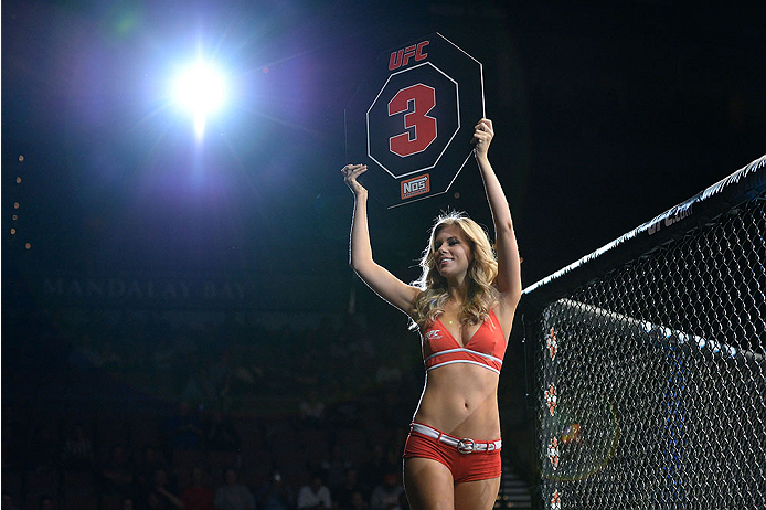LAS VEGAS, NV - NOVEMBER 30:  UFC Octagon Girl Chrissy Blair signals the start of round three between Drew Dober and Sean Spencer in their welterweight fight during The Ultimate Fighter season 18 live finale inside the Mandalay Bay Events Center on November 30, 2013 in Las Vegas, Nevada. (Photo by Jeff Bottari/Zuffa LLC/Zuffa LLC via Getty Images) *** Local Caption *** Chrissy Blair
