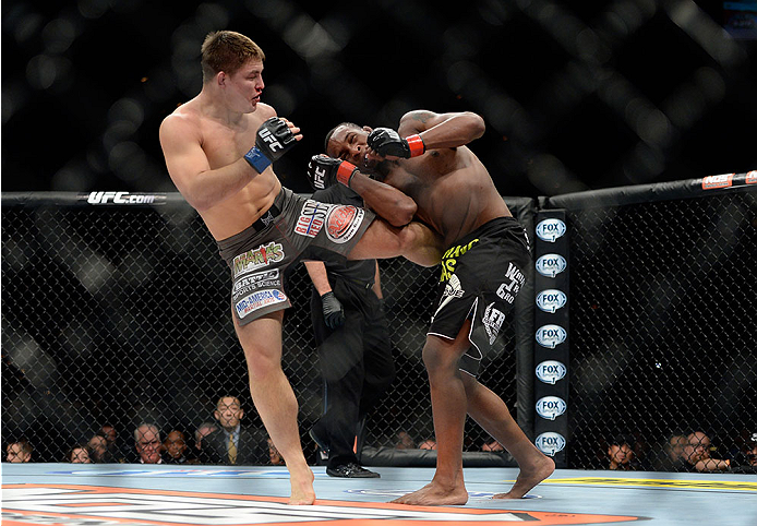 LAS VEGAS, NV - NOVEMBER 30:  (L-R) Drew Dober kicks Sean Spencer in their welterweight fight during The Ultimate Fighter season 18 live finale inside the Mandalay Bay Events Center on November 30, 2013 in Las Vegas, Nevada. (Photo by Jeff Bottari/Zuffa LLC/Zuffa LLC via Getty Images) *** Local Caption *** Sean Spencer; Drew Dober