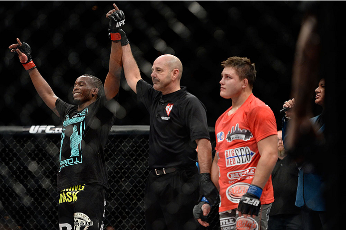 LAS VEGAS, NV - NOVEMBER 30:  (L-R) Sean Spencer celebrates after defeating Drew Dober in their welterweight fight during The Ultimate Fighter season 18 live finale inside the Mandalay Bay Events Center on November 30, 2013 in Las Vegas, Nevada. (Photo by Jeff Bottari/Zuffa LLC/Zuffa LLC via Getty Images) *** Local Caption *** Sean Spencer; Drew Dober