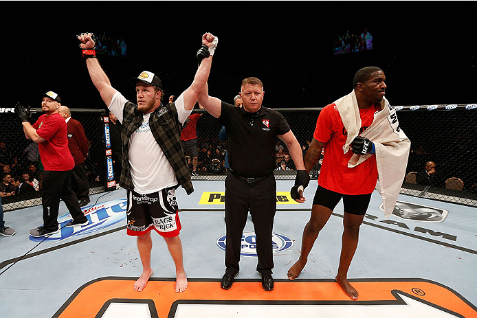 LAS VEGAS, NV - NOVEMBER 30:  (L-R) Jared Rosholt celebrates after defeating Walt Harris in their heavyweight fight during The Ultimate Fighter season 18 live finale inside the Mandalay Bay Events Center on November 30, 2013 in Las Vegas, Nevada. (Photo by Josh Hedges/Zuffa LLC/Zuffa LLC via Getty Images) *** Local Caption *** Jared Rosholt; Walt Harris