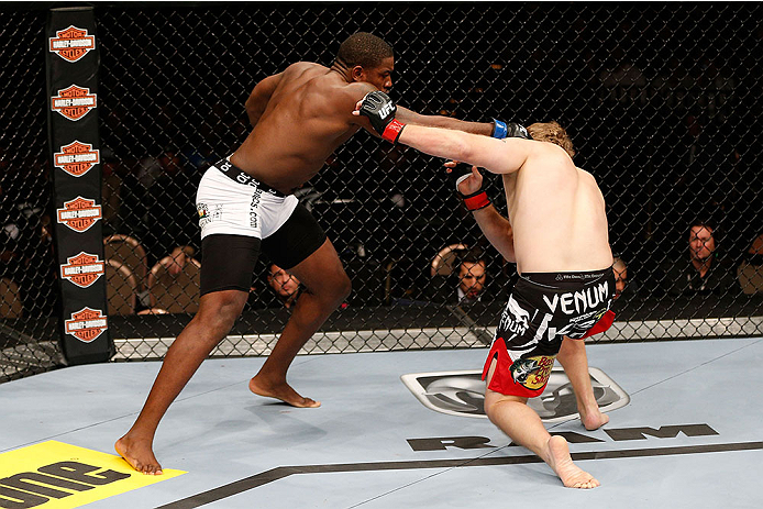 LAS VEGAS, NV - NOVEMBER 30:  (L-R) Walt Harris punches Jared Rosholt in their heavyweight fight during The Ultimate Fighter season 18 live finale inside the Mandalay Bay Events Center on November 30, 2013 in Las Vegas, Nevada. (Photo by Josh Hedges/Zuffa LLC/Zuffa LLC via Getty Images) *** Local Caption *** Jared Rosholt; Walt Harris