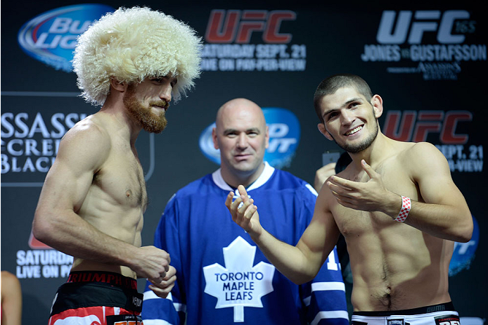 TORONTO, CANADA - SEPTEMBER 20:  (L-R) Pat Healy and Khabib Nurmagomedov face off during the UFC 165 weigh-in at the Maple Leaf Square on September 20, 2013 in Toronto, Ontario, Canada. (Photo by Jeff Bottari/Zuffa LLC/Zuffa LLC via Getty Images)