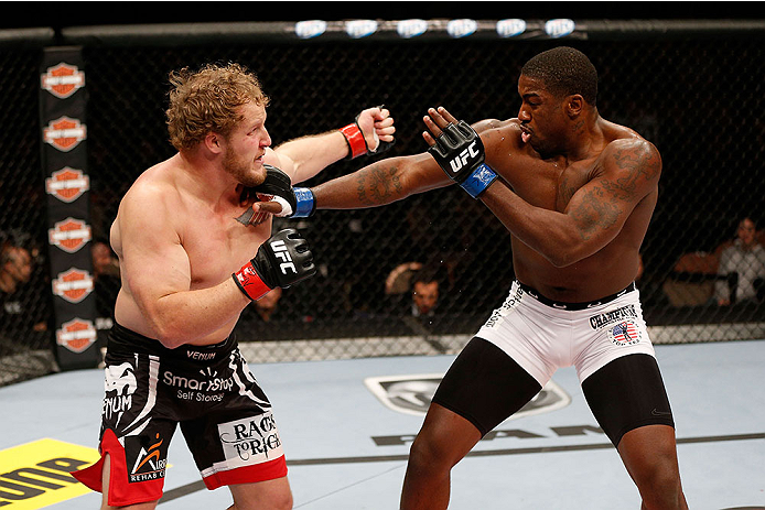 LAS VEGAS, NV - NOVEMBER 30:  (L-R) Jared Rosholt punches Walt Harris in their heavyweight fight during The Ultimate Fighter season 18 live finale inside the Mandalay Bay Events Center on November 30, 2013 in Las Vegas, Nevada. (Photo by Josh Hedges/Zuffa LLC/Zuffa LLC via Getty Images) *** Local Caption *** Jared Rosholt; Walt Harris