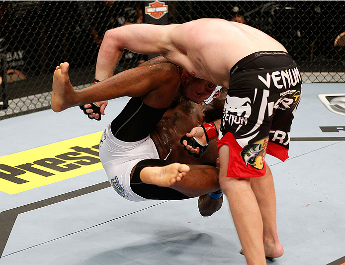 LAS VEGAS, NV - NOVEMBER 30:  Jared Rosholt (black shorts) takes down Walt Harris in their heavyweight fight during The Ultimate Fighter season 18 live finale inside the Mandalay Bay Events Center on November 30, 2013 in Las Vegas, Nevada. (Photo by Josh Hedges/Zuffa LLC/Zuffa LLC via Getty Images) *** Local Caption *** Jared Rosholt; Walt Harris