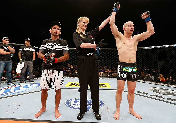 LAS VEGAS, NV - NOVEMBER 30:  (R-L) Tom Niinimaki celebrates after defeating Rani Yahya in their featherweight fight during The Ultimate Fighter season 18 live finale inside the Mandalay Bay Events Center on November 30, 2013 in Las Vegas, Nevada. (Photo by Josh Hedges/Zuffa LLC/Zuffa LLC via Getty Images) *** Local Caption *** Rani Yahya; Tom Niinimaki