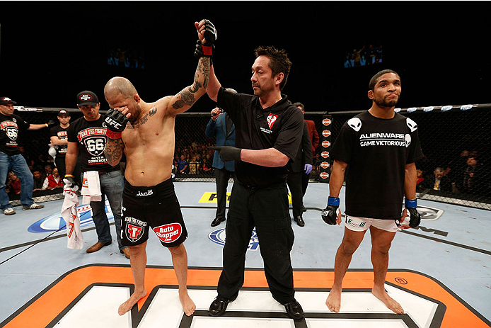 LAS VEGAS, NV - NOVEMBER 30:  (L-R) Akira Corassani is announced the winner over Maximo Blanco by stoppage due to an illegal knee to the face of Corassani by Blanco in their featherweight fight during The Ultimate Fighter season 18 live finale inside the Mandalay Bay Events Center on November 30, 2013 in Las Vegas, Nevada. (Photo by Josh Hedges/Zuffa LLC/Zuffa LLC via Getty Images) *** Local Caption *** Akira Corassani; Maximo Blanco