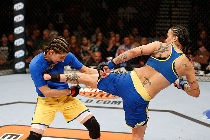 LAS VEGAS, NV - NOVEMBER 30:  (L-R) Roxanne Modafferi gets kicked by Raquel Pennington in their women's bantamweight fight during The Ultimate Fighter season 18 live finale inside the Mandalay Bay Events Center on November 30, 2013 in Las Vegas, Nevada. (Photo by Josh Hedges/Zuffa LLC/Zuffa LLC via Getty Images) *** Local Caption *** Roxanne Modafferi; Raquel Pennington