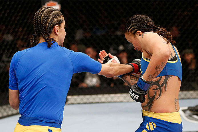 LAS VEGAS, NV - NOVEMBER 30:  (L-R) Roxanne Modafferi punches Raquel Pennington in their women's bantamweight fight during The Ultimate Fighter season 18 live finale inside the Mandalay Bay Events Center on November 30, 2013 in Las Vegas, Nevada. (Photo by Josh Hedges/Zuffa LLC/Zuffa LLC via Getty Images) *** Local Caption *** Roxanne Modafferi; Raquel Pennington