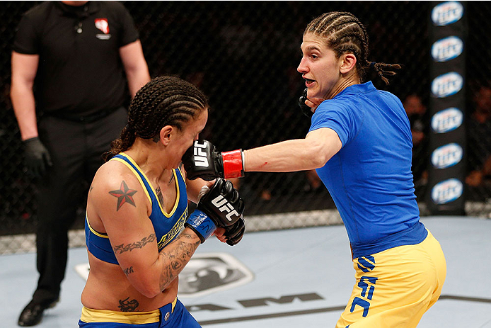 LAS VEGAS, NV - NOVEMBER 30:  (R-L) Roxanne Modafferi punches Raquel Pennington in their women's bantamweight fight during The Ultimate Fighter season 18 live finale inside the Mandalay Bay Events Center on November 30, 2013 in Las Vegas, Nevada. (Photo by Josh Hedges/Zuffa LLC/Zuffa LLC via Getty Images) *** Local Caption *** Roxanne Modafferi; Raquel Pennington