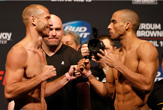 "ORLANDO, FL - APRIL 18:  (L-R) Opponents Donald ""Cowboy"" Cerrone and Edson Barboza face off during the FOX UFC Saturday weigh-in at the Amway Center on April 18, 2014 in Orlando, Florida. (Photo by Josh Hedges/Zuffa LLC/Zuffa LLC via Getty Images)"