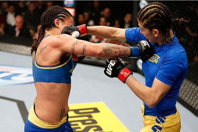 LAS VEGAS, NV - NOVEMBER 30:  (L-R) Raquel Pennington punches Roxanne Modafferi in their women's bantamweight fight during The Ultimate Fighter season 18 live finale inside the Mandalay Bay Events Center on November 30, 2013 in Las Vegas, Nevada. (Photo by Josh Hedges/Zuffa LLC/Zuffa LLC via Getty Images) *** Local Caption *** Roxanne Modafferi; Raquel Pennington