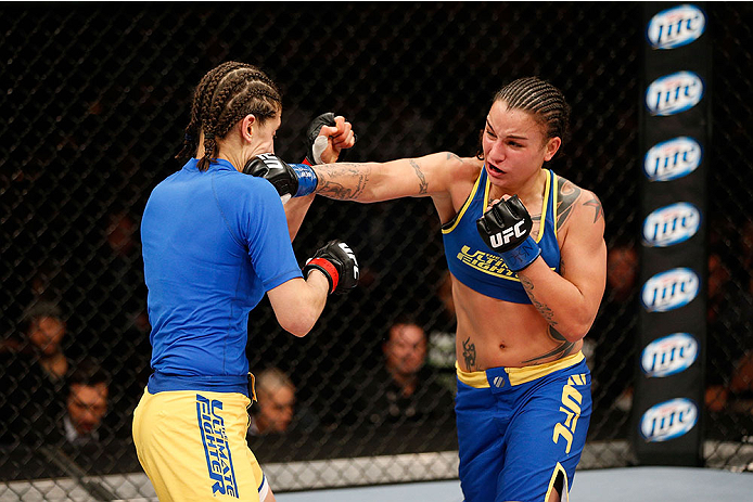 LAS VEGAS, NV - NOVEMBER 30:  (R-L) Raquel Pennington punches Roxanne Modafferi in their women's bantamweight fight during The Ultimate Fighter season 18 live finale inside the Mandalay Bay Events Center on November 30, 2013 in Las Vegas, Nevada. (Photo by Josh Hedges/Zuffa LLC/Zuffa LLC via Getty Images) *** Local Caption *** Roxanne Modafferi; Raquel Pennington