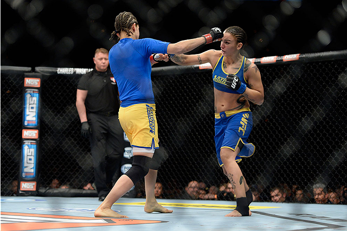 LAS VEGAS, NV - NOVEMBER 30:  (R-L) Raquel Pennington punches Roxanne Modafferi in their women's bantamweight fight during The Ultimate Fighter season 18 live finale inside the Mandalay Bay Events Center on November 30, 2013 in Las Vegas, Nevada. (Photo by Jeff Bottari/Zuffa LLC/Zuffa LLC via Getty Images) *** Local Caption *** Roxanne Modafferi; Raquel Pennington