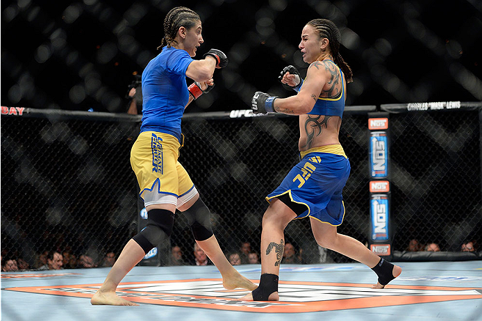 LAS VEGAS, NV - NOVEMBER 30:  (R-L) Raquel Pennington exchange punches Roxanne Modafferi in their women's bantamweight fight during The Ultimate Fighter season 18 live finale inside the Mandalay Bay Events Center on November 30, 2013 in Las Vegas, Nevada. (Photo by Jeff Bottari/Zuffa LLC/Zuffa LLC via Getty Images) *** Local Caption *** Roxanne Modafferi; Raquel Pennington