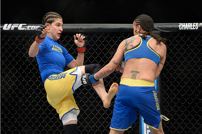 LAS VEGAS, NV - NOVEMBER 30:  (L-R) Roxanne Modafferi kicks Raquel Pennington in their women's bantamweight fight during The Ultimate Fighter season 18 live finale inside the Mandalay Bay Events Center on November 30, 2013 in Las Vegas, Nevada. (Photo by Jeff Bottari/Zuffa LLC/Zuffa LLC via Getty Images) *** Local Caption *** Roxanne Modafferi; Raquel Pennington