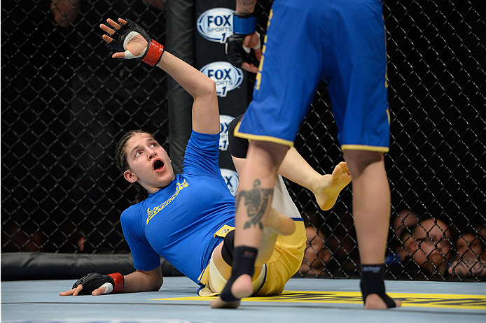 LAS VEGAS, NV - NOVEMBER 30:  (L-R) Roxanne Modafferi looks to block an attack from Raquel Pennington in their women's bantamweight fight during The Ultimate Fighter season 18 live finale inside the Mandalay Bay Events Center on November 30, 2013 in Las Vegas, Nevada. (Photo by Jeff Bottari/Zuffa LLC/Zuffa LLC via Getty Images) *** Local Caption *** Roxanne Modafferi; Raquel Pennington