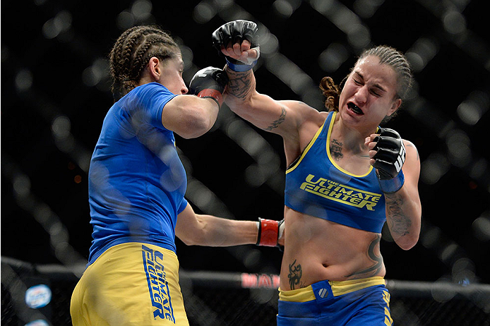 LAS VEGAS, NV - NOVEMBER 30:  (R-L) Raquel Pennington misses on a punch against Roxanne Modafferi in their women's bantamweight fight during The Ultimate Fighter season 18 live finale inside the Mandalay Bay Events Center on November 30, 2013 in Las Vegas, Nevada. (Photo by Jeff Bottari/Zuffa LLC/Zuffa LLC via Getty Images) *** Local Caption *** Roxanne Modafferi; Raquel Pennington