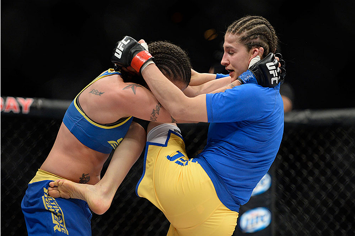 LAS VEGAS, NV - NOVEMBER 30:  (R-L) Roxanne Modafferi lands a knee to the body of Raquel Pennington in their women's bantamweight fight during The Ultimate Fighter season 18 live finale inside the Mandalay Bay Events Center on November 30, 2013 in Las Vegas, Nevada. (Photo by Jeff Bottari/Zuffa LLC/Zuffa LLC via Getty Images) *** Local Caption *** Roxanne Modafferi; Raquel Pennington
