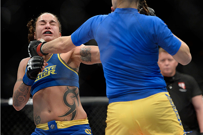 LAS VEGAS, NV - NOVEMBER 30:  (L-R) Raquel Pennington gets punched by Roxanne Modafferi in their women's bantamweight fight during The Ultimate Fighter season 18 live finale inside the Mandalay Bay Events Center on November 30, 2013 in Las Vegas, Nevada. (Photo by Jeff Bottari/Zuffa LLC/Zuffa LLC via Getty Images) *** Local Caption *** Roxanne Modafferi; Raquel Pennington