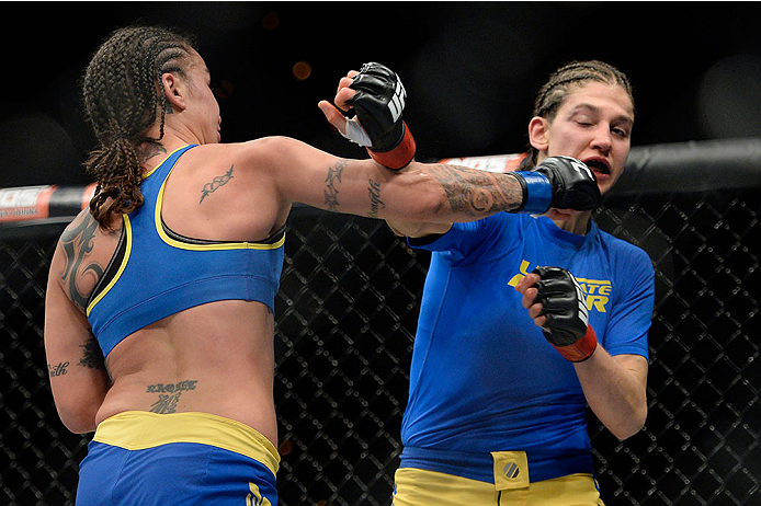 LAS VEGAS, NV - NOVEMBER 30:  (L-R) Raquel Pennington punches Roxanne Modafferi in their women's bantamweight fight during The Ultimate Fighter season 18 live finale inside the Mandalay Bay Events Center on November 30, 2013 in Las Vegas, Nevada. (Photo by Jeff Bottari/Zuffa LLC/Zuffa LLC via Getty Images) *** Local Caption *** Roxanne Modafferi; Raquel Pennington