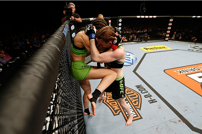 LAS VEGAS, NV - NOVEMBER 30:  (L-R) Jessamyn Duke lands a knee to the body Peggy Morgan in their women's bantamweight fight during The Ultimate Fighter season 18 live finale inside the Mandalay Bay Events Center on November 30, 2013 in Las Vegas, Nevada. (Photo by Josh Hedges/Zuffa LLC/Zuffa LLC via Getty Images) *** Local Caption *** Jessamyn Duke; Peggy Morgan