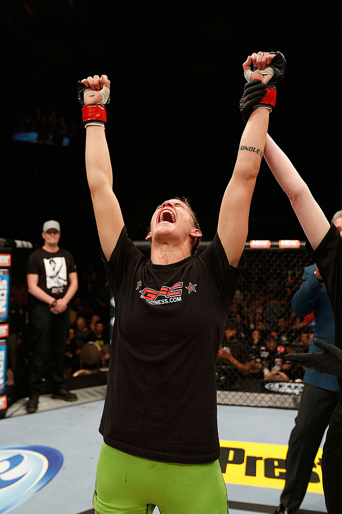 LAS VEGAS, NV - NOVEMBER 30:  Jessamyn Duke celebrates after defeating Peggy Morgan in their women's bantamweight fight during The Ultimate Fighter season 18 live finale inside the Mandalay Bay Events Center on November 30, 2013 in Las Vegas, Nevada. (Photo by Josh Hedges/Zuffa LLC/Zuffa LLC via Getty Images) *** Local Caption *** Jessamyn Duke; Peggy Morgan