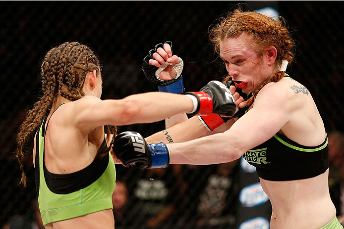 LAS VEGAS, NV - NOVEMBER 30:  (L-R) Jessamyn Duke punches Peggy Morgan in their women's bantamweight fight during The Ultimate Fighter season 18 live finale inside the Mandalay Bay Events Center on November 30, 2013 in Las Vegas, Nevada. (Photo by Josh Hedges/Zuffa LLC/Zuffa LLC via Getty Images) *** Local Caption *** Jessamyn Duke; Peggy Morgan