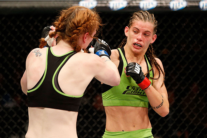 LAS VEGAS, NV - NOVEMBER 30:  (R-L) Jessamyn Duke punches Peggy Morgan in their women's bantamweight fight during The Ultimate Fighter season 18 live finale inside the Mandalay Bay Events Center on November 30, 2013 in Las Vegas, Nevada. (Photo by Josh Hedges/Zuffa LLC/Zuffa LLC via Getty Images) *** Local Caption *** Jessamyn Duke; Peggy Morgan