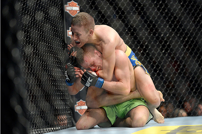 LAS VEGAS, NV - NOVEMBER 30:  Chris Holdsworth submits David Grant in their bantamweight final fight during The Ultimate Fighter season 18 live finale inside the Mandalay Bay Events Center on November 30, 2013 in Las Vegas, Nevada. (Photo by Jeff Bottari/Zuffa LLC/Zuffa LLC via Getty Images) *** Local Caption *** Chris Holdsworth; David Grant