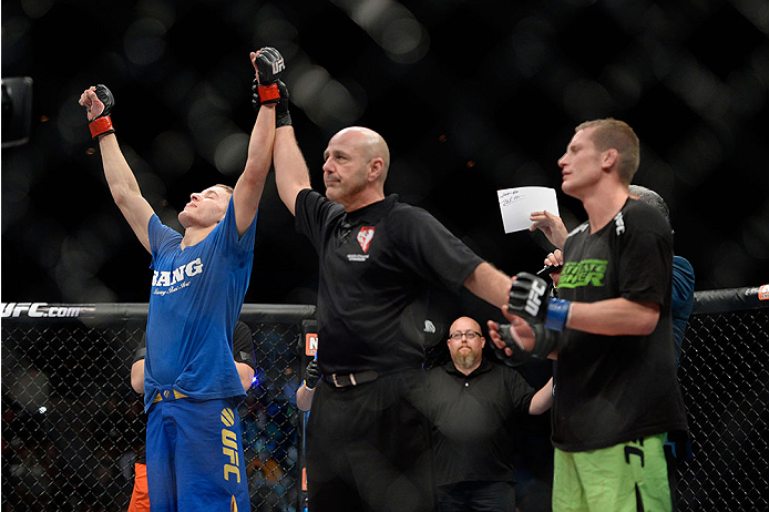 LAS VEGAS, NV - NOVEMBER 30:  (L-R) Chris Holdsworth celebrates after defeating David Grant in their bantamweight final fight during The Ultimate Fighter season 18 live finale inside the Mandalay Bay Events Center on November 30, 2013 in Las Vegas, Nevada. (Photo by Jeff Bottari/Zuffa LLC/Zuffa LLC via Getty Images) *** Local Caption *** Chris Holdsworth; David Grant