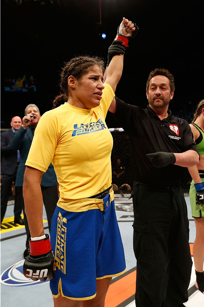 LAS VEGAS, NV - NOVEMBER 30:  Julianna Pena celebrates after defeating Jessica Rakoczy in their women's bantamweight final fight during The Ultimate Fighter season 18 live finale inside the Mandalay Bay Events Center on November 30, 2013 in Las Vegas, Nevada. (Photo by Josh Hedges/Zuffa LLC/Zuffa LLC via Getty Images) *** Local Caption *** Julianna Pena