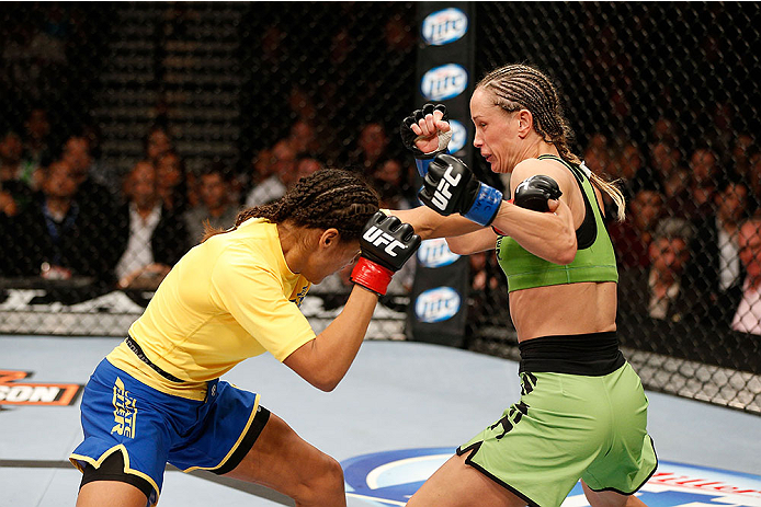 LAS VEGAS, NV - NOVEMBER 30:  (R-L) Jessica Rakoczy punches Julianna Pena in their women's bantamweight final fight during The Ultimate Fighter season 18 live finale inside the Mandalay Bay Events Center on November 30, 2013 in Las Vegas, Nevada. (Photo by Josh Hedges/Zuffa LLC/Zuffa LLC via Getty Images) *** Local Caption *** Julianna Pena; Jessica Rakoczy