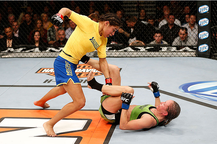 LAS VEGAS, NV - NOVEMBER 30:  (L-R) Julianna Pena punches Jessica Rakoczy in their women's bantamweight final fight during The Ultimate Fighter season 18 live finale inside the Mandalay Bay Events Center on November 30, 2013 in Las Vegas, Nevada. (Photo by Josh Hedges/Zuffa LLC/Zuffa LLC via Getty Images) *** Local Caption *** Julianna Pena; Jessica Rakoczy