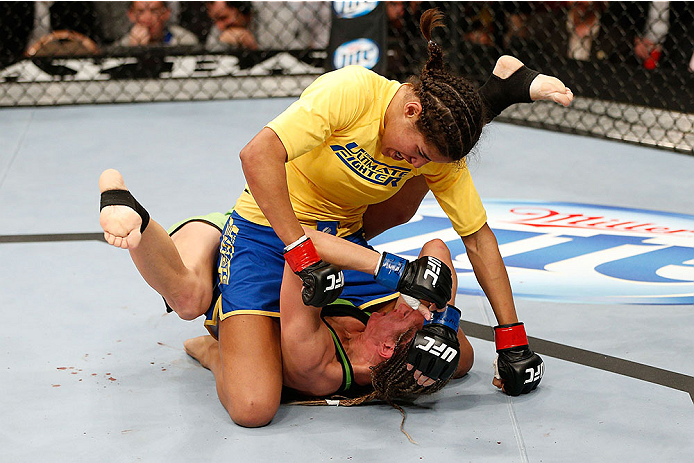 LAS VEGAS, NV - NOVEMBER 30:  (L-R) Julianna Pena controls Jessica Rakoczy in their women's bantamweight final fight during The Ultimate Fighter season 18 live finale inside the Mandalay Bay Events Center on November 30, 2013 in Las Vegas, Nevada. (Photo by Josh Hedges/Zuffa LLC/Zuffa LLC via Getty Images) *** Local Caption *** Julianna Pena; Jessica Rakoczy