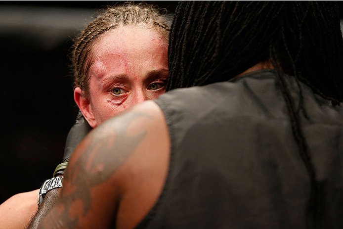 LAS VEGAS, NV - NOVEMBER 30:  Jessica Rakoczy is consoled by her corner after being defeated by Julianna Pena in their women's bantamweight final fight during The Ultimate Fighter season 18 live finale inside the Mandalay Bay Events Center on November 30, 2013 in Las Vegas, Nevada. (Photo by Josh Hedges/Zuffa LLC/Zuffa LLC via Getty Images) *** Local Caption *** Jessica Rakoczy
