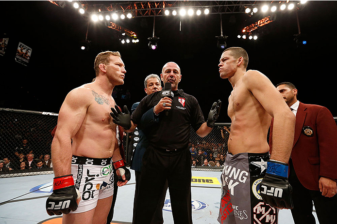LAS VEGAS, NV - NOVEMBER 30:  (L-R) Gray Maynard and Nate Diaz meet at the center of the Octagon before their lightweight fight during The Ultimate Fighter season 18 live finale inside the Mandalay Bay Events Center on November 30, 2013 in Las Vegas, Nevada. (Photo by Josh Hedges/Zuffa LLC/Zuffa LLC via Getty Images) *** Local Caption *** Gray Maynard; Nate Diaz