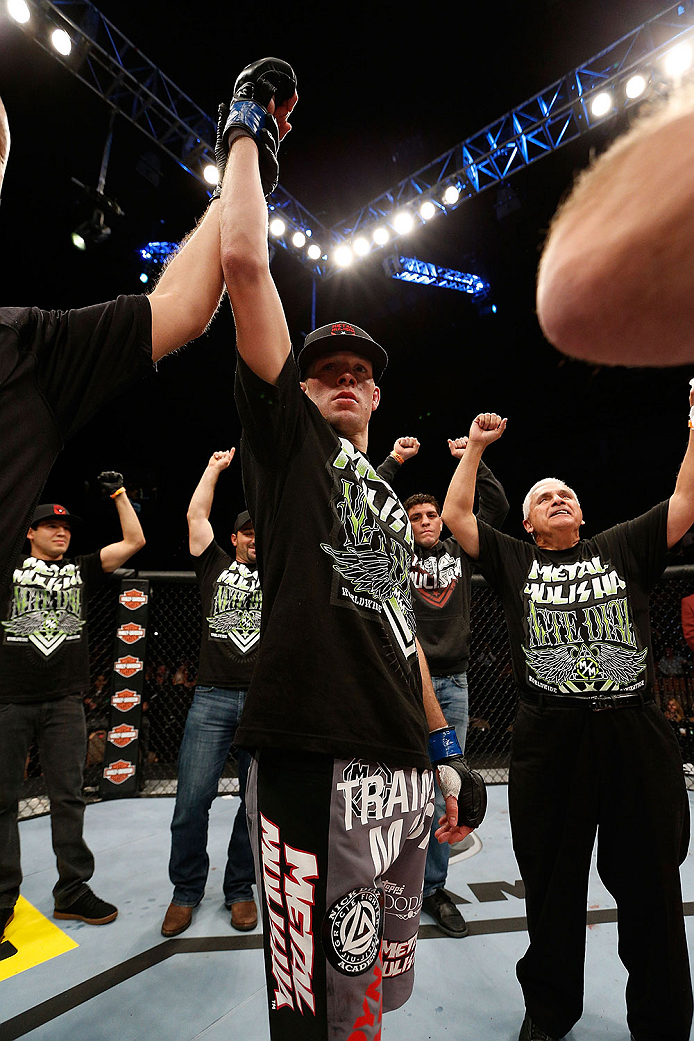 LAS VEGAS, NV - NOVEMBER 30:  Nate Diaz celebrates after knocking out Gray Maynard in their lightweight fight during The Ultimate Fighter season 18 live finale inside the Mandalay Bay Events Center on November 30, 2013 in Las Vegas, Nevada. (Photo by Josh Hedges/Zuffa LLC/Zuffa LLC via Getty Images) *** Local Caption ***  Nate Diaz