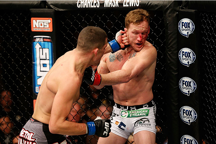 LAS VEGAS, NV - NOVEMBER 30:  (L-R) Nate Diaz punches Gray Maynard in their lightweight fight during The Ultimate Fighter season 18 live finale inside the Mandalay Bay Events Center on November 30, 2013 in Las Vegas, Nevada. (Photo by Josh Hedges/Zuffa LLC/Zuffa LLC via Getty Images) *** Local Caption *** Gray Maynard; Nate Diaz