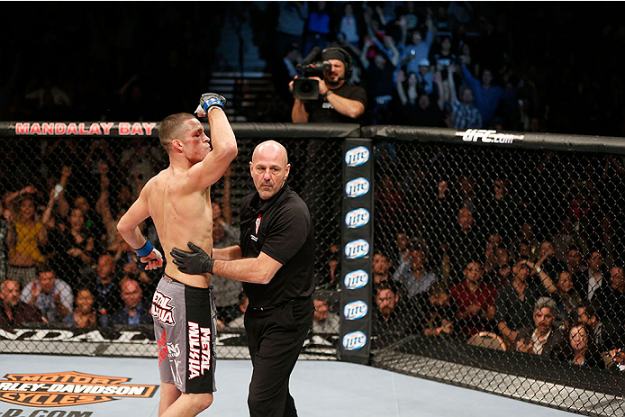 LAS VEGAS, NV - NOVEMBER 30:  (L-R) Nate Diaz is called off by referee Yves Lavigne after knocking out Gray Maynard in their lightweight fight during The Ultimate Fighter season 18 live finale inside the Mandalay Bay Events Center on November 30, 2013 in Las Vegas, Nevada. (Photo by Josh Hedges/Zuffa LLC/Zuffa LLC via Getty Images) *** Local Caption *** Gray Maynard; Nate Diaz; Yves Lavigne