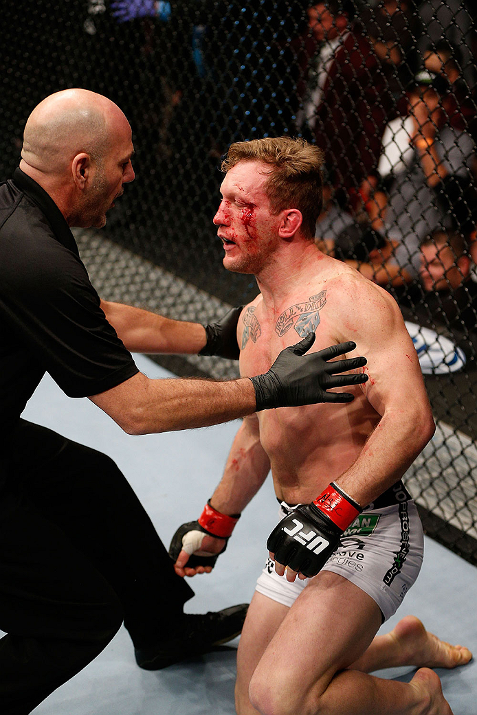 LAS VEGAS, NV - NOVEMBER 30:  (R-L) Gray Maynard is talked to by referee Yves Lavigne after Maynard was knocked out by Diaz in their lightweight fight during The Ultimate Fighter season 18 live finale inside the Mandalay Bay Events Center on November 30, 2013 in Las Vegas, Nevada. (Photo by Josh Hedges/Zuffa LLC/Zuffa LLC via Getty Images) *** Local Caption *** Gray Maynard; Yves Lavigne