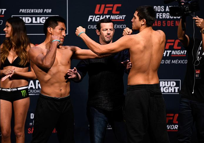 MEXICO CITY, MEXICO - NOVEMBER 04:  (L-R) Enrique Barzola of the Peru and Chris Avila of the United States face off during the UFC weigh-in at the Arena Ciudad de Mexico on November 4, 2016 in Mexico City, Mexico. (Photo by Jeff Bottari/Zuffa LLC/Zuffa LLC via Getty Images)
