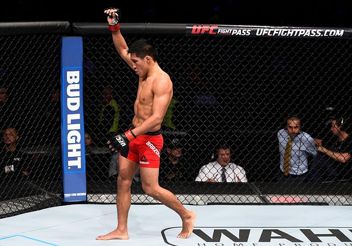 MEXICO CITY, MEXICO - NOVEMBER 05:  Enrique Barzola of Peru raises his hand after facing Chris Avila of the United States in their featherweight bout during the UFC Fight Night event at Arena Ciudad de Mexico on November 5, 2016 in Mexico City, Mexico. (Photo by Jeff Bottari/Zuffa LLC/Zuffa LLC via Getty Images)