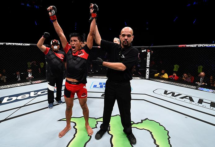 MEXICO CITY, MEXICO - NOVEMBER 05:  Enrique Barzola of Peru celebrates his victory over Chris Avila of the United States in their featherweight bout during the UFC Fight Night event at Arena Ciudad de Mexico on November 5, 2016 in Mexico City, Mexico. (Photo by Jeff Bottari/Zuffa LLC/Zuffa LLC via Getty Images)